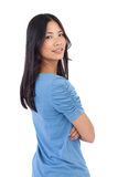Smiling asian woman with arms crossed looking over her shoulder Stock Image