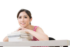 Smiling Asian woman with books Stock Photo