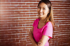 Smiling asian woman crossing arms Royalty Free Stock Photos