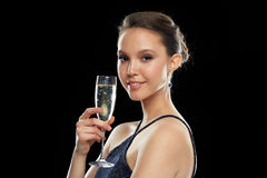 Smiling asian woman drinking champagne at party Stock Image