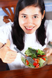 Smiling asian woman enjoying a fresh healthy salad Stock Photo