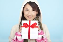 Smiling asian woman with a gift Stock Photo