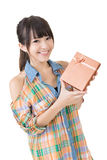 Smiling asian woman with a gift. Young smiling asian woman with a gift. Isolated on the white background Royalty Free Stock Image