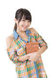 Smiling asian woman with a gift Royalty Free Stock Photos