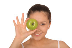 Smiling asian woman with green apple Royalty Free Stock Photos