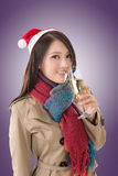 Smiling Asian woman hold a  glass of champagne Royalty Free Stock Photography