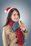 Smiling Asian woman hold a  glass of champagne Stock Image