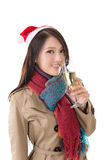 Smiling Asian woman hold a  glass of champagne Stock Photos