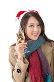Smiling Asian woman hold a  glass of champagne Royalty Free Stock Images
