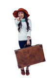 Smiling Asian woman holding luggage pointing the camera Royalty Free Stock Photo