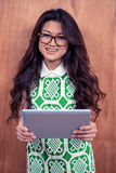 Smiling Asian woman holding tablet and looking at the camera Royalty Free Stock Image