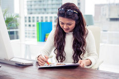Smiling Asian woman looking at documents Stock Image