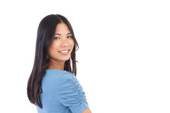 Smiling asian woman looking over her shoulder Stock Photos