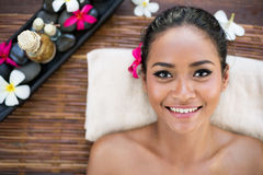 Smiling Asian woman on massage desk Royalty Free Stock Photo