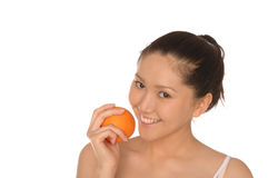 Smiling asian woman with orange Stock Photography