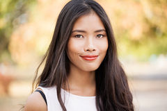 Smiling Asian Woman Outdoors Stock Photo