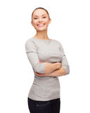Smiling asian woman over with crossed arms Royalty Free Stock Image