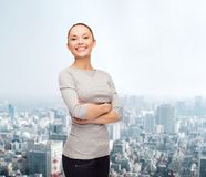 Smiling asian woman over with crossed arms Royalty Free Stock Images