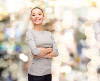 Smiling asian woman over with crossed arms Royalty Free Stock Photo