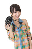 Smiling asian woman with photo camera Stock Photo