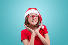 Smiling asian woman portrait with christmas santa hat isolated o Royalty Free Stock Photos