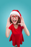 Smiling asian woman portrait with christmas santa hat shouting i Royalty Free Stock Image