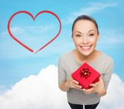 Smiling asian woman with red gift box Stock Images