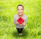 Smiling asian woman with red gift box Royalty Free Stock Photo