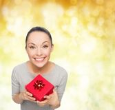 Smiling asian woman with red gift box Stock Photos