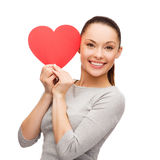Smiling asian woman with red heart Royalty Free Stock Photography