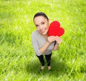 Smiling asian woman with red heart Royalty Free Stock Photos