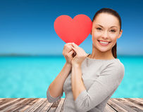 Smiling asian woman with red heart Stock Image