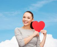 Smiling asian woman with red heart Royalty Free Stock Photo