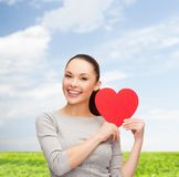 Smiling asian woman with red heart Stock Photo