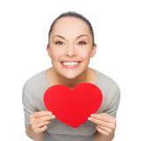 Smiling asian woman with red heart Royalty Free Stock Image
