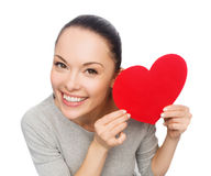 Smiling asian woman with red heart Royalty Free Stock Images