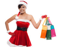 Smiling asian  woman in red santa costume with colorful shopping Stock Photography
