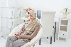 Smiling asian woman relaxing at home Stock Photography