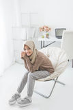 Smiling asian woman relaxing at home Stock Images
