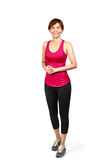 Smiling asian woman in sports wear Stock Photo