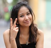 Smiling asian woman on the street Stock Photography