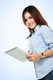 Smiling asian woman touching tablet PC Royalty Free Stock Photography