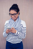 Smiling Asian woman using smartphone Royalty Free Stock Photo