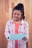Smiling Asian woman using tablet Stock Photography