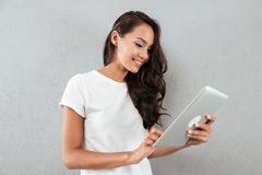 Smiling asian woman using tablet computer Stock Images