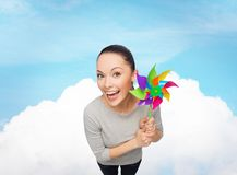 Smiling asian woman with windmill Royalty Free Stock Images