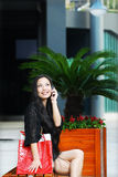 Smiling asian women on cell phone Stock Photo