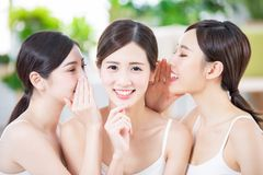Skin care asian women friend. Smiling asian women friend talk to the person at the middle stock image