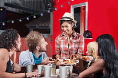 Friend Sharing Slices of Pizza Royalty Free Stock Photo