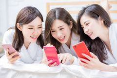 Women share with smartphone stock photos